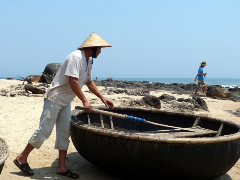 Fisherman and round boat