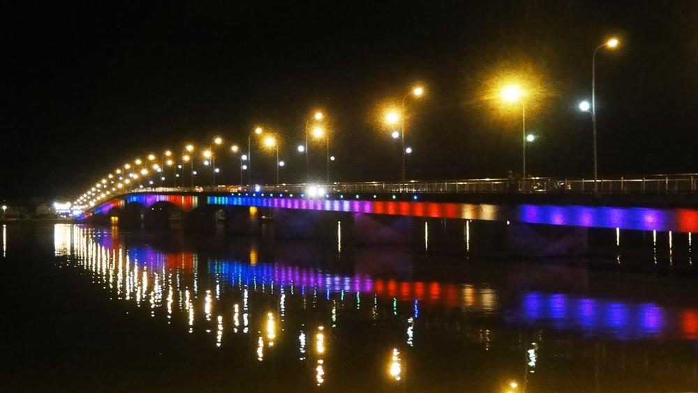 Nhat Le River bridge at night