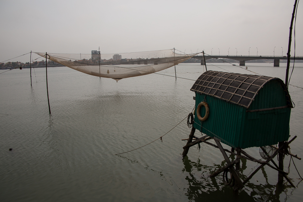 River fish net and fish house