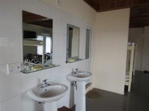 Dorm sinks/2 showers behind sinks